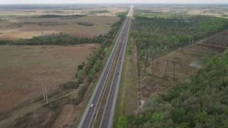 AX0034_065 - 5K stock footage aerial video of following the Expressway through a rural area, La Belle, Florida