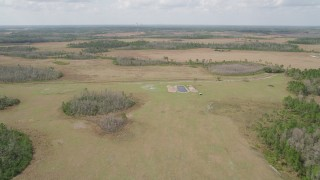 AX0034_067 - 5K stock footage aerial video of flying over marshland, Wedgefield, Florida