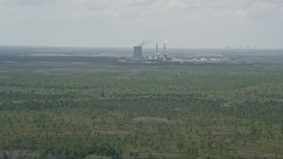 AX0034_073 - 5K stock footage aerial video of approaching a coal fired power generation facility, Orlando, Florida
