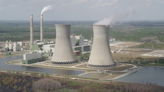 AX0034_079 - 5K stock footage aerial video of passing by a coal fired power generation facility, Orlando, Florida