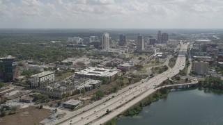 AX0034_098 - 5K stock footage aerial video of a wide view of Interstate 4 and Downtown Orlando, Florida