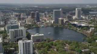 AX0034_103 - 5K stock footage aerial video of passing by Lake Eola and Downtown Orlando, Florida
