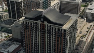 AX0034_108 - 5K stock footage aerial video of orbiting a high-rise apartment building, Downtown Orlando, Florida