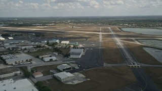 AX0034_115 - 5K stock footage aerial video of flying by Orlando Executive Airport, Florida