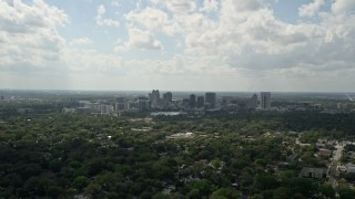AX0035_001 - 5K stock footage aerial video of Downtown Orlando skyline seen from a distance, Florida