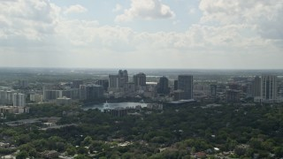 AX0035_002 - 5K aerial stock footage video of Downtown Orlando and Lake Eola, Florida
