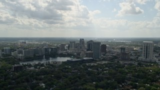 AX0035_003 - 5K stock footage aerial video of Downtown Orlando buildings along Lake Eola, Florida