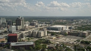 AX0035_006 - 5K stock footage aerial video of Amway Center arena, Downtown Orlando, Florida