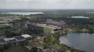 AX0035_007 - 5K stock footage aerial video of approaching Lake Lorna Doone and Citrus Bowl football stadium, Orlando, Florida