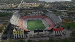 AX0035_008 - 5K stock footage aerial video of flying by Citrus Bowl football stadium in Orlando, Florida