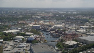 AX0035_014 - 5K stock footage aerial video of flying by Universal Studios Florida theme park, Orlando, Florida