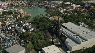 AX0035_017 - 5K stock footage aerial video of Wizarding World of Harry Potter, Universal Studios, Orlando, Florida