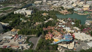 AX0035_020 - 5K stock footage aerial video of theme park rides at Universal Studios, Orlando, Florida