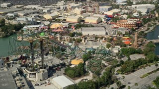 AX0035_021 - 5K stock footage aerial video of of Incredible Hulk Coaster at Universal Studios theme park, Orlando, Florida