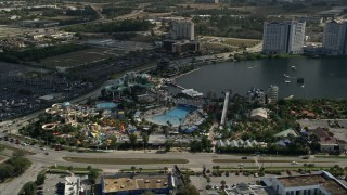 AX0035_024 - 5K stock footage aerial video of orbiting Wet 'n Wild water park, Orlando, Florida
