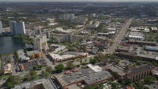 AX0035_025 - 5K stock footage aerial video approach Magical Midway thrill park, Orlando, Florida