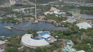 AX0035_031 - 5K stock footage aerial video of orbiting Seaworld Orlando theme park, Florida