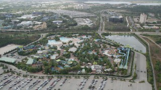 AX0035_034 - 5K stock footage aerial video of orbiting Aquatica Florida water park, revealing SeaWorld Orlando, Florida