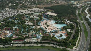 AX0035_035 - 5K stock footage aerial video of circling the Aquatica Florida water park, Orlando, Florida