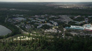 AX0035_044 - 5K stock footage aerial video of approaching Disney's All Star Sports Resort, Orlando, Florida