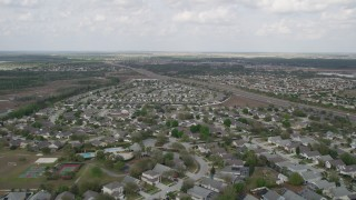 AX0035_084 - 5K stock footage aerial video of suburban neighborhood homes, Clermont, Florida
