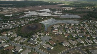 AX0035_085 - 5K stock footage aerial video flyby residential neighborhood and wetlands, Clermont, Florida