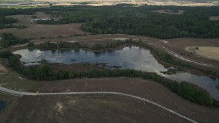 AX0035_087 - 5K stock footage aerial video approach a small lake in Clermont, Florida