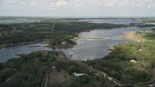AX0035_097 - 5K stock footage aerial video of homes on the shore of Lake Avalon, Florida