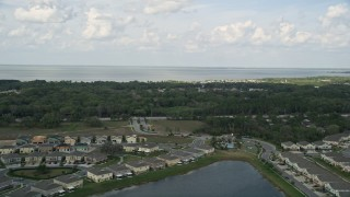 AX0035_105 - 5K stock footage aerial video fly over waterfront homes to approach a lake in Winter Garden, Florida