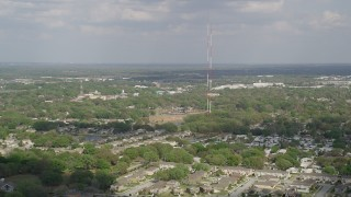 AX0035_107 - 5K stock footage aerial video flyby radio towers in Winter Garden, Florida