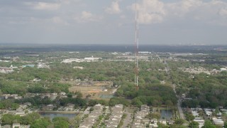 AX0035_108 - 5K stock footage aerial video of orbiting a radio tower, Winter Garden, Florida