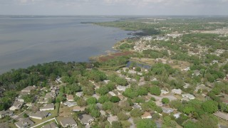 AX0035_110 - 5K stock footage aerial video fly over residential neighborhoods near the shore, Winter Garden, Florida