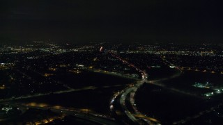 AX0156_001 - 8K stock footage aerial video approaching the 5 and 170 freeway split at night in Pacoima, California