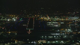 AX0156_003 - 8K stock footage aerial video of the runways at Burbank Airport lit up for the night, California