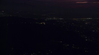 AX0156_007 - 8K stock footage aerial video of a view of the Griffith Observatory in the hills at night in Los Angeles, California