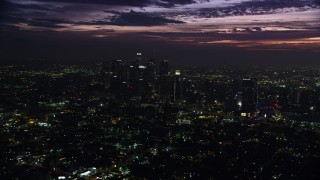 AX0156_023 - 8K stock footage aerial video of Downtown Los Angeles skyscrapers at sunrise, California