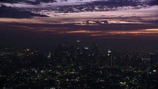 AX0156_024 - 8K stock footage aerial video of clouds above Downtown Los Angeles skyscrapers at sunrise, California