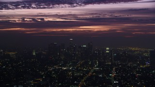 AX0156_025 - 8K stock footage aerial video of clouds over tall Downtown Los Angeles skyscrapers at sunrise, California