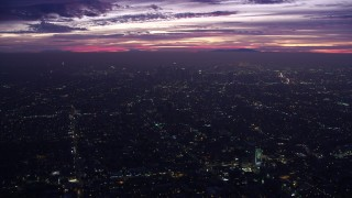 AX0156_030 - 8K stock footage aerial video of a wide view of Downtown Los Angeles skyscrapers at sunrise, California