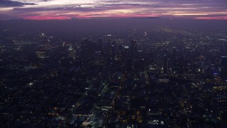 AX0156_034 - 8K stock footage aerial video approaching to Downtown Los Angeles skyscrapers at sunrise, California