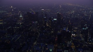 AX0156_035 - 8K stock footage aerial video flying over Downtown Los Angeles skyscrapers at sunrise, California