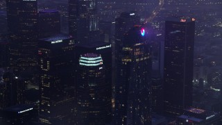 AX0156_037 - 8K stock footage aerial video of a reverse view of Wilshire Grand Center in Downtown Los Angeles at sunrise, California