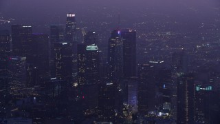 AX0156_038 - 8K stock footage aerial video of a reverse view of skyscrapers in Downtown Los Angeles at sunrise, California
