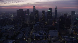 AX0156_044 - 8K stock footage aerial video on approach to the Downtown Los Angeles skyline at sunrise, California