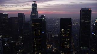 AX0156_045 - 8K stock footage aerial video approaching and fly between skyscrapers in Downtown Los Angeles at sunrise, California