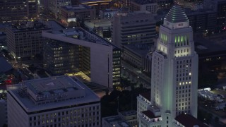 AX0156_047 - 8K stock footage aerial video of LAPD Headquarters, LA Times Building, and City Hall in Downtown Los Angeles at sunrise, California