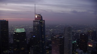 AX0156_049 - 8K stock footage aerial video flying by the Wilshire Grand Center in Downtown Los Angeles at sunrise, California