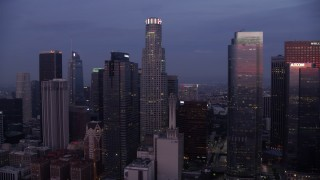 AX0156_053 - 8K stock footage aerial video passing by towering skyscrapers in Downtown Los Angeles at sunrise, California
