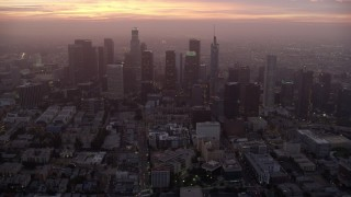 AX0156_063 - 8K stock footage aerial video of Downtown Los Angeles as the sun rises, California
