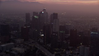 AX0156_064 - 8K stock footage aerial video of Downtown Los Angeles, California as the sun rises, and reveal The Ritz-Carlton